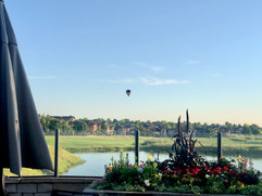 Hot air balloon over hole one from the patio