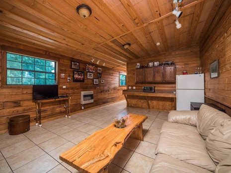 Climate controlled lounge with kitchenette and barn apartments