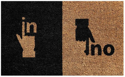 hand in our printed natural coir mat