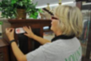 Volunteer Jennifer Richardson puts a sol