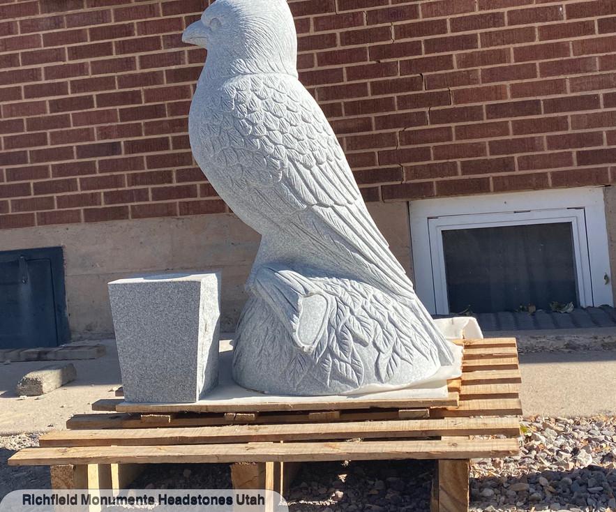 custom carved statue headstone cardinal