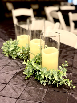 Cylinders with Greenery Centerpieces