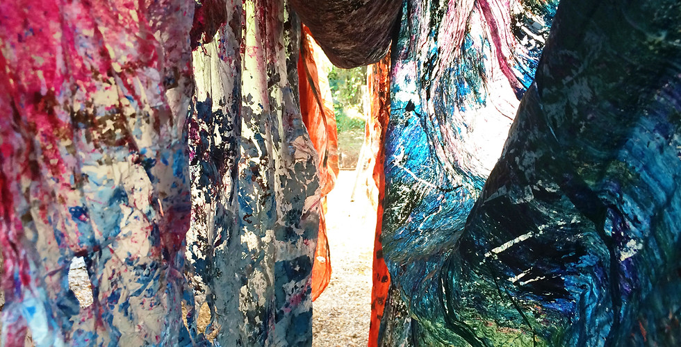 """Intriguing tunnel view amongst eolic """"laundry"""": canvases laid for drying purposes."""