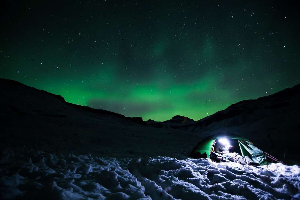 Northern Lights dance over the tent