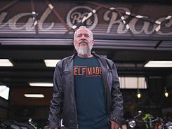 t-shirt-mockup-of-a-biker-guy-outside-a-