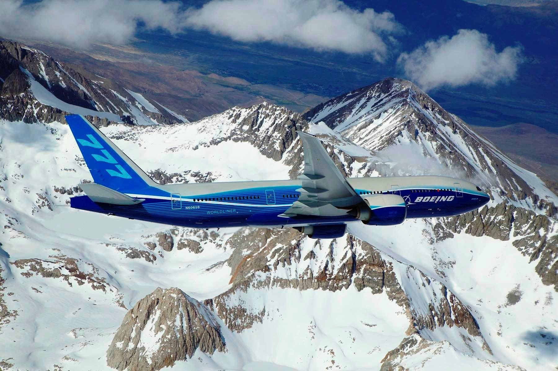 Boeing_777-200LR_banking_over_mountain.jpg