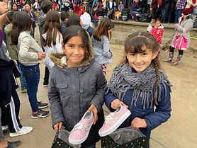 Providing 400 pairs of new shoes for children in Tijuana.