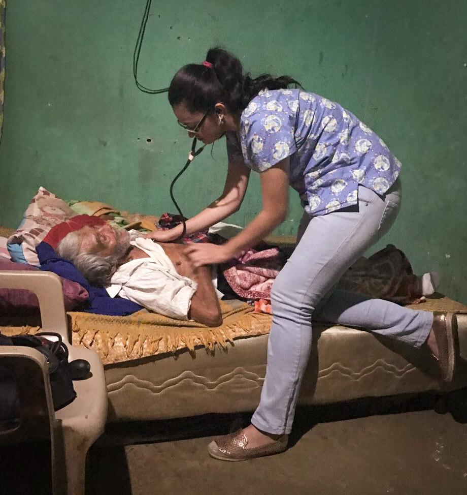 A volunteer doctor helps an elderly man near Santa Catarina Mita as part of the Medical Clinic's outreach program.