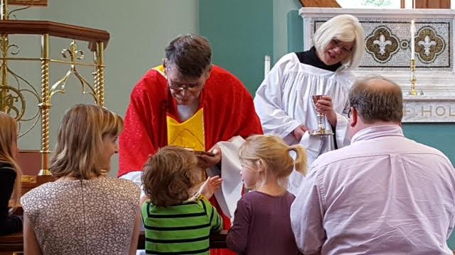 Children receiving communion at St. Brendan's.