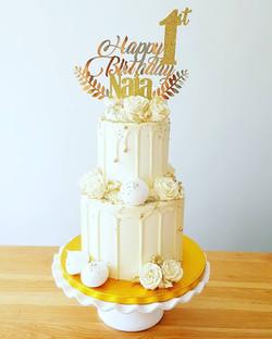 All white drip cake