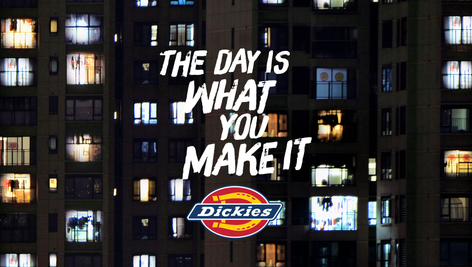 Camera begins to PAN out of her window into the dusk. We see a building, and then a street, and then a city ablaze with light as new lights keep turning on from different windows, shops, spaces—a village of Inspired Makers.   SUPER: DICKIES: THE DAY IS WHAT YOU MAKE IT