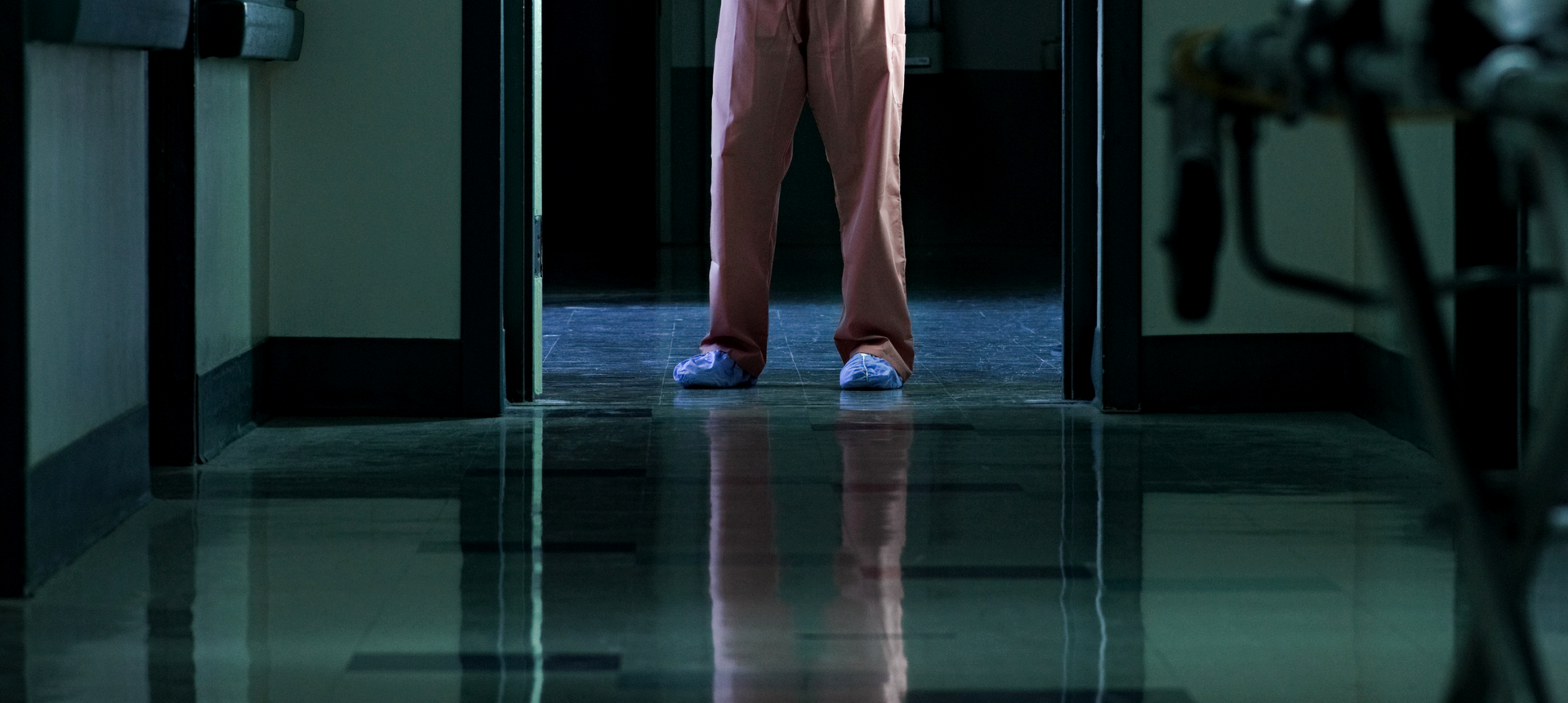 Soft, instrumental music   Female NURSE hurries into a hospital NICU, dimly lit by computer screens and whirring machines. She turns on a light over an incubator to reveal a tiny baby in clear distress, silently wailing.  SFX: CLICK