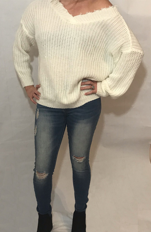 Distressed V-Neck Sweater/Distressed Skinny Jeans