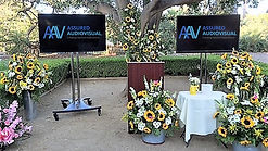 Photo of two outdoor television rentals for an outdoor funeral service