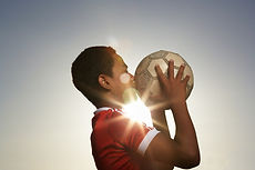 Photo of boy with socer ball linked to te Publications page