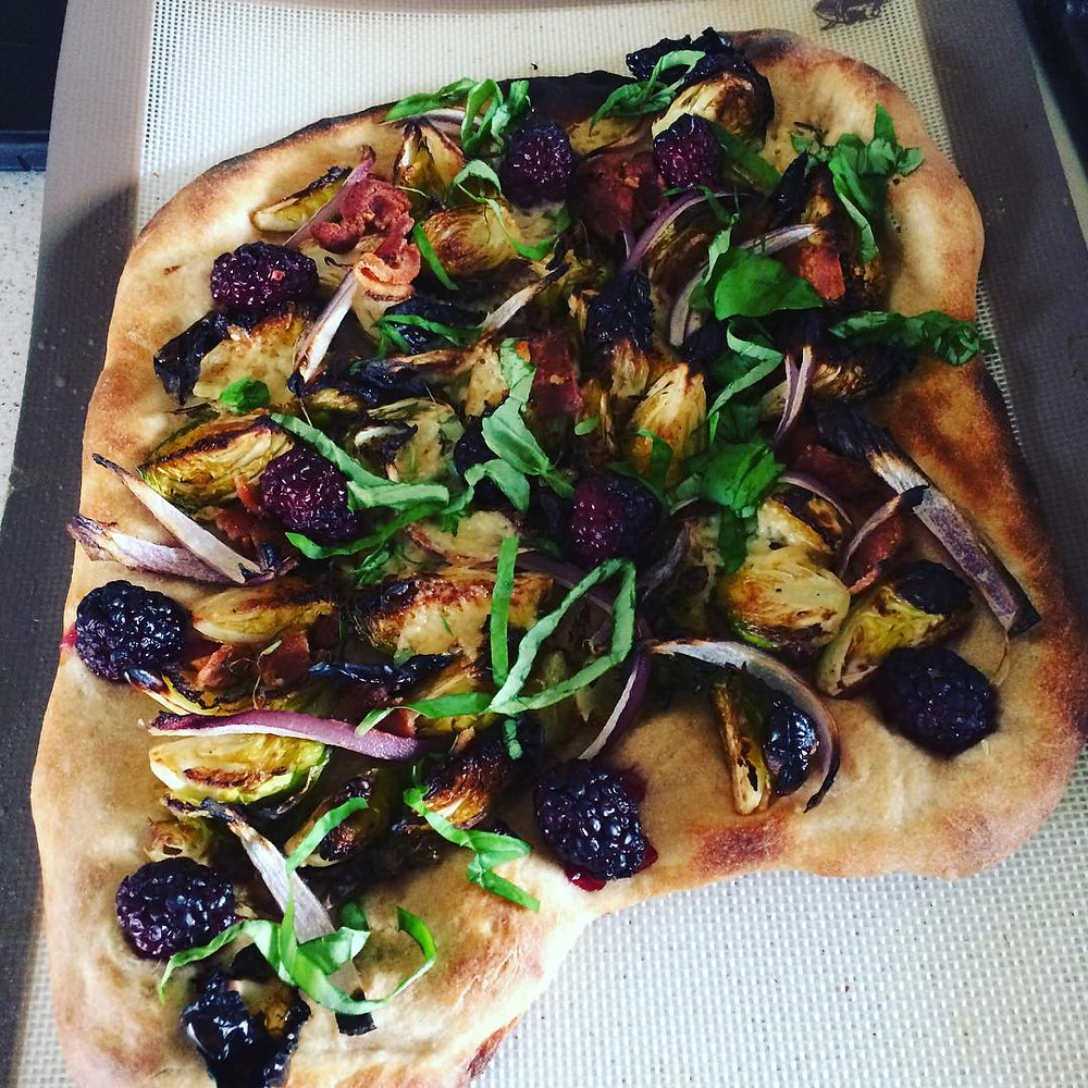 sourdough pizza with blackberries and brussels sprouts