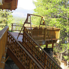 shaded deck in the afternoon and stairs leading to floating dock