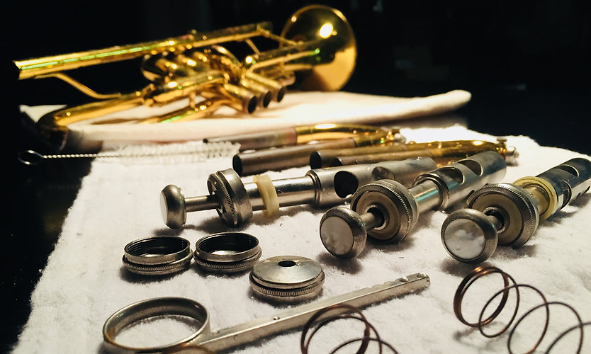 Brass trumpet pieces lay out during inst