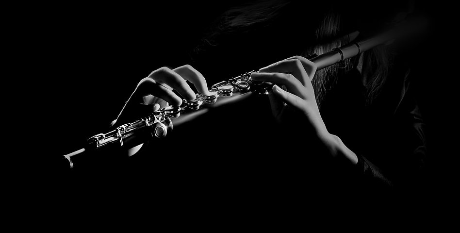Flute instrument closeup Flutist hands playing flute music isolated on black background_edited.jpg