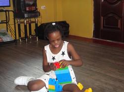Philomen building her blocks