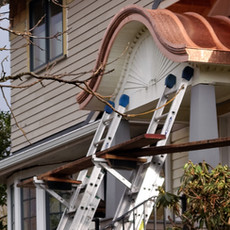 copper roofing panels on curved porch roof.jpg
