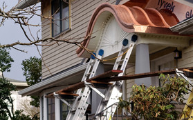Curved Copper Porch Roof