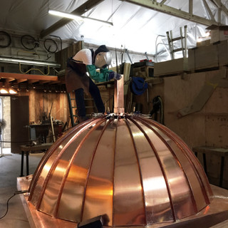 Putting Finishing Touches on a Copper Dome