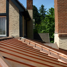 copper roofing panels and flashing.jpeg