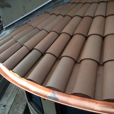 installed copper radius half round gutter