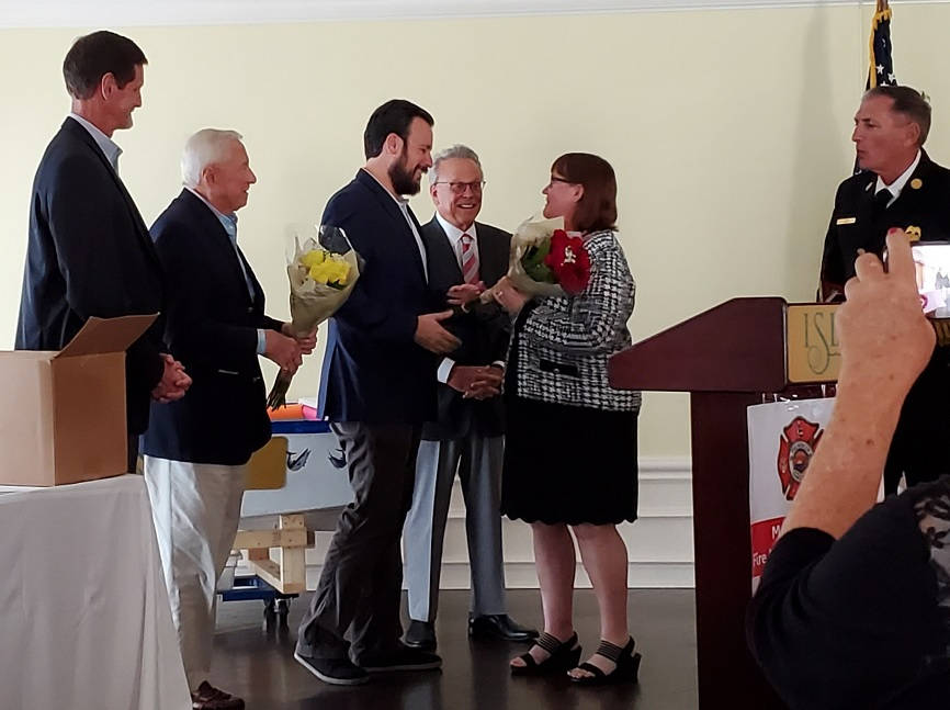 Jared congratulating Betsy Novakovich for winning the Community Service Award at the annual Marco Island Fire Foundation luncheon.