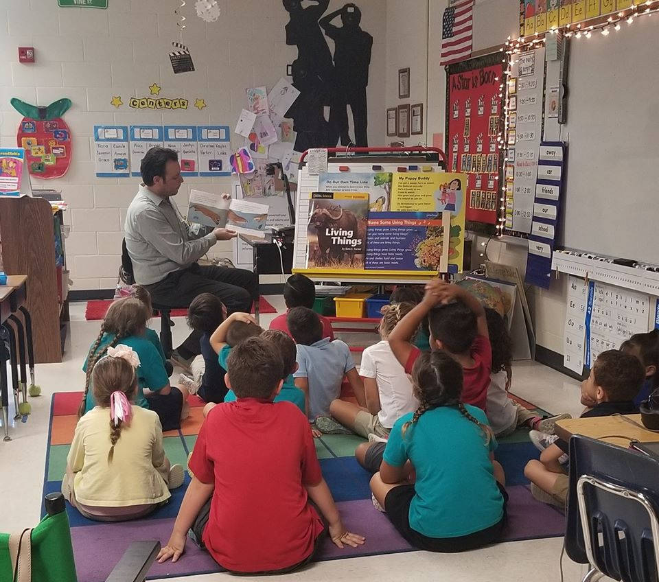 "Jared reading to Tommie Barfield Elementary School Students on ""Read Across America Day""."