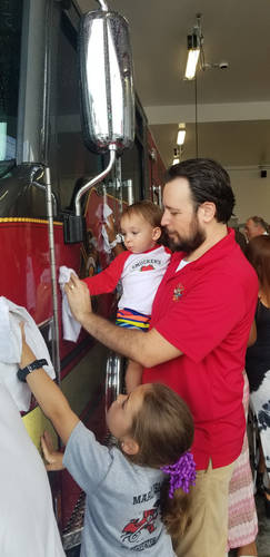 Jared and his children, Tosca and Lorenzo, helping to clean up Marco Island's newest fire engine at Fire Station #51 Push-In Ceremony.