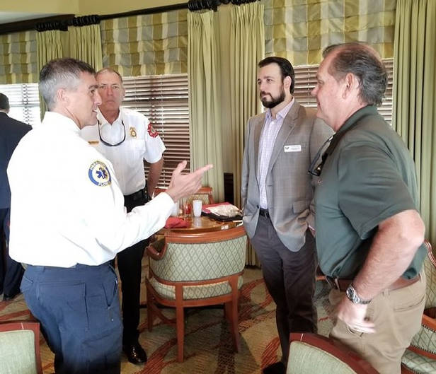 Jared discussing the issues with Deputy Chief Dave Battiato, Chief Mike Murphy, and Chris Byrne, Emergency Management Recovery Coordinator, at Meet Your City Officials breakfast at the Island Country Club.