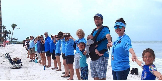 """Jared and his family at the """"Hands Across the Water"""" rally for clean water and wildlife held at South Beach on Marco Island."""