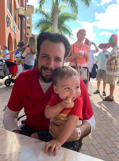 Jared and his youngest son, Lorenzo enjoying the Jerry Adams Chili Cookoff hosted by the Marco Island Fire Foundation, at the Esplanade.