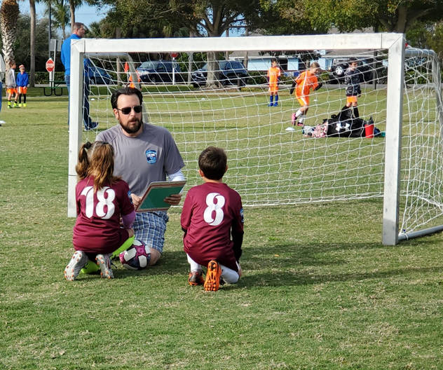 Jared coaching soccer with the Optimist Club of Marco Island at Mackle Park.