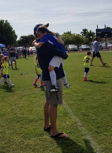 Jared celebrating his daughter Tosca's soccer game win at Winterberry field.