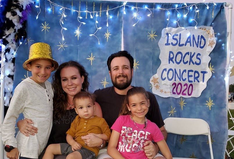 Jared and his family attending the Island Rocks Concert at Veterans' Community Park.
