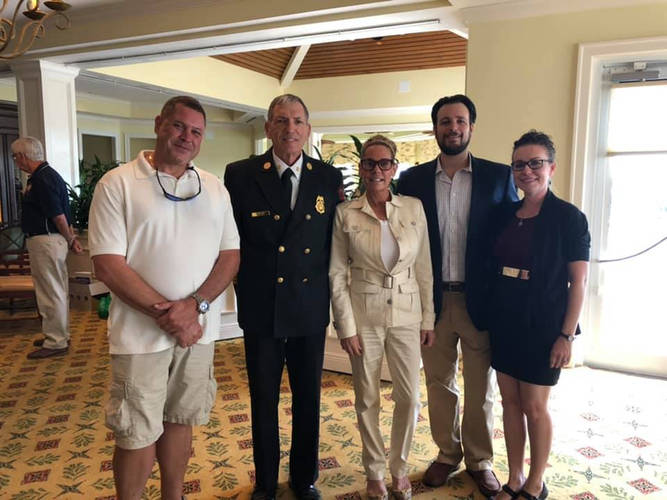 Jared and his wife, Elsa, with Chief Mike Murphy and Marco Patriots Board Members, Matt Melican and Erin Mia Milchman at a Fire Foundation Luncheon.