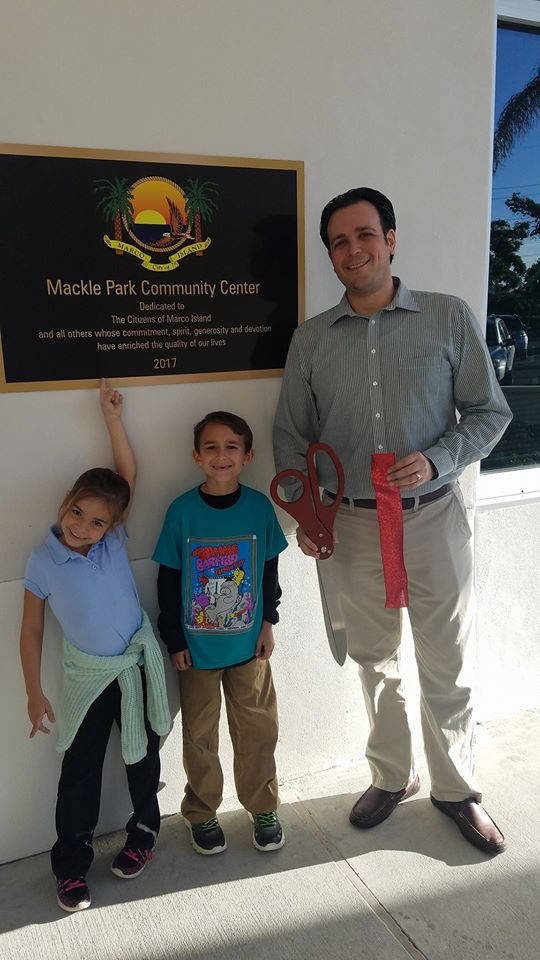 Jared and his children at the Mackle Park Community Center ribbon cutting.