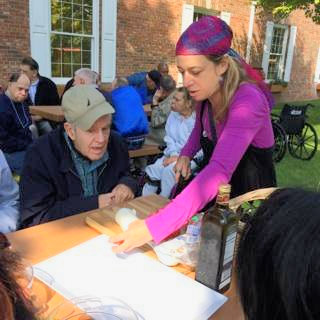Carol teaches visitors from JVS