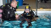 Baptême de plongée en bassin pour des touristes venants de loin.....