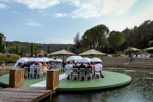 Umbrellas double as parasols during this wedding ceremony