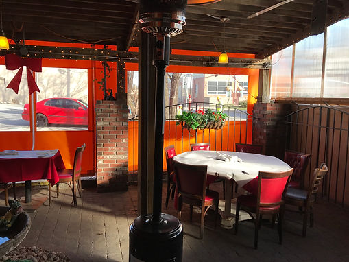 Le Fou Frog enclosed patio with heaters