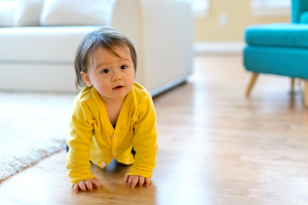Baby crawling in yellow robe