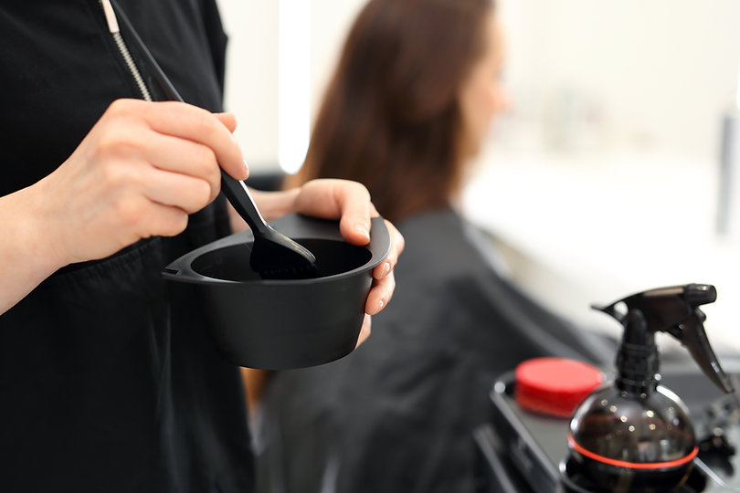 Barber hair dye is applied with a brush.