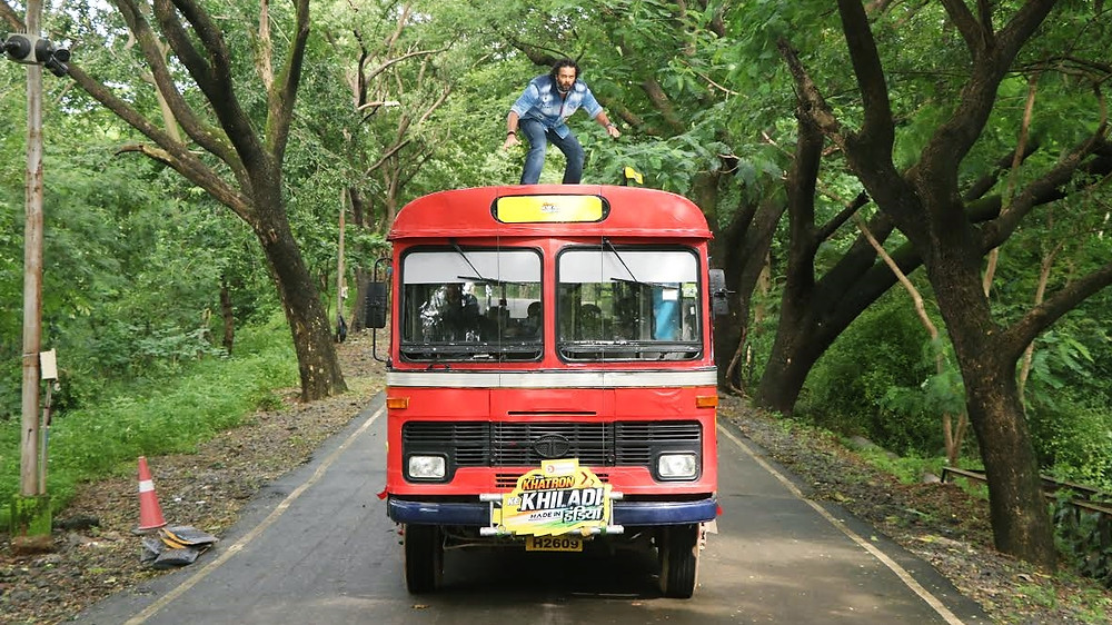 ROHIT SHETTY SURFS A BEST BUS! MAKES AN ACTION-PACKED ENTRY IN KHATRON KE KHILADI MADE IN INDIA!