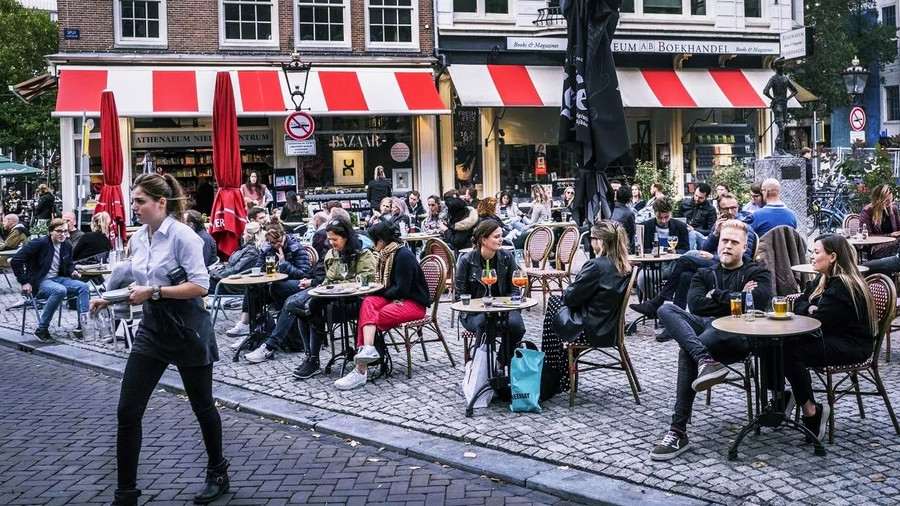 NETHERLANDS GOES INTO PARTIAL LOCKDOWN TO CONTAIN CORONAVIRUS SPREAD