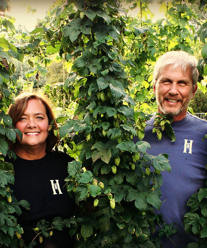 John and Marie in their HomeGrown Hop Yard