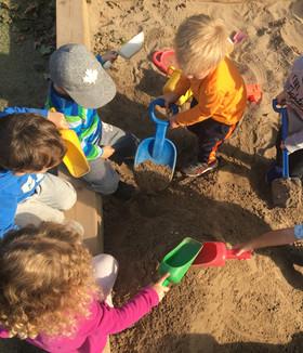 Sand play together.jpg